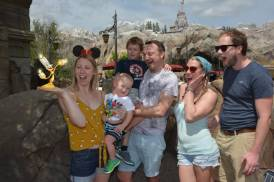 Me and my family (husband, sister, brother in law and 2 children) at Disney world Florida outside beauty and the beast's castle. I am holding Lumiere on my hand!