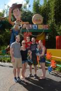 all of us outside the toy story land sign