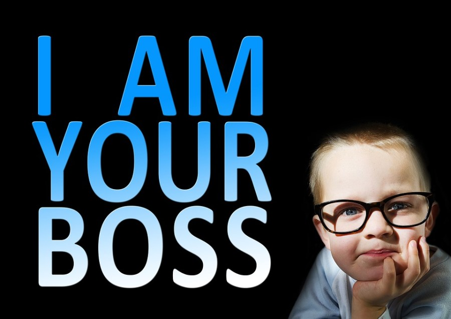 I am your boss written on black background and a child looking at you