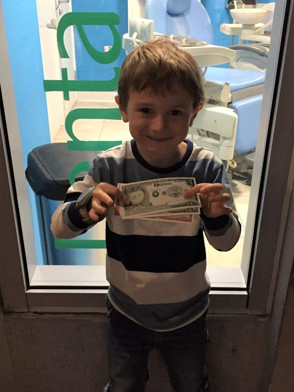 Jake holding his kidzania pounds called Kidzos