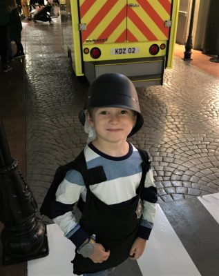 Jake as a policeman protecting Kidzania at the fire