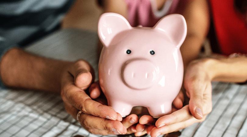 teaching kids the value of money, a piggy bank
