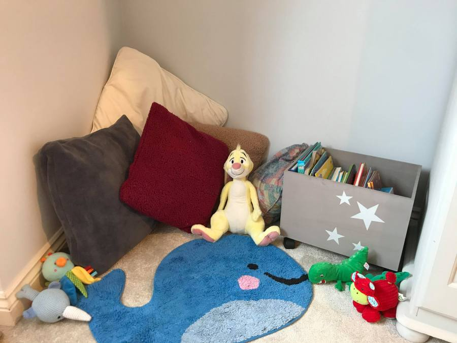 reading nook with cushions, toys and books