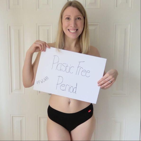 me wearing the WUKA pants and holding up a sign saying plastic free period