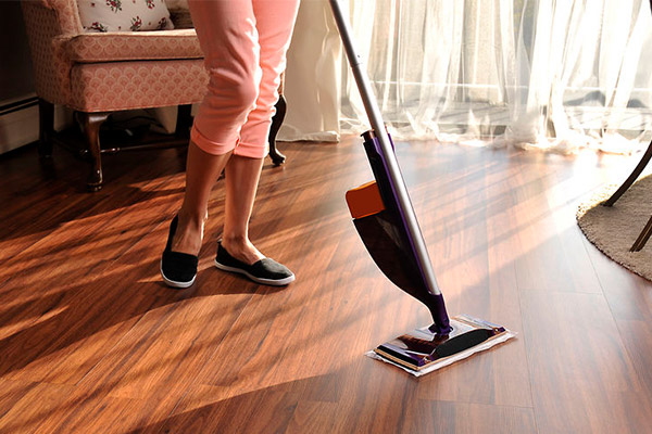 luvanto floor being cleaned with a mop