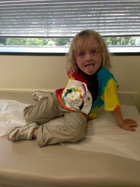 doctor's appointments are BO-ring! i think she's got a pretty good Gene Simmons going. Halloween?