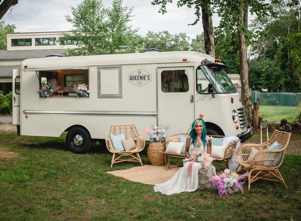 queenies cocktail bus at backyard wedding