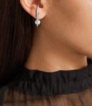 https://www.net-a-porter.com/gb/en/product/835964/maria_black/lila-twirl-18-karat-gold-diamond-earrings