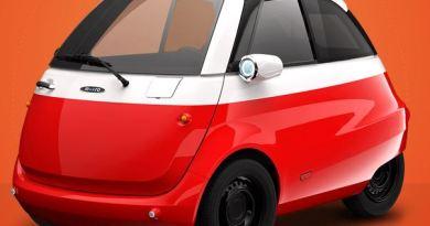 Microlino-car_com-rot-600-€-Fahrer-Seite-Klein-Elektroauto-20-PS-90-kmh-ab-12.000-€-Foto-Microlino - Krieg im Micro Elektroautomarkt. Microlino gegen Karolino und Karo.