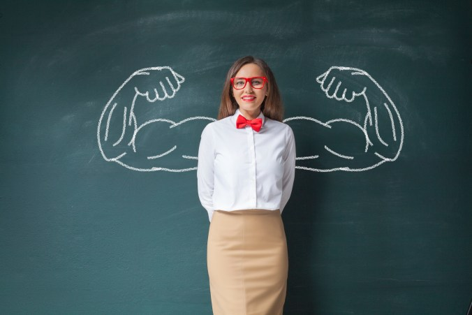 Assertive young woman with metaphorical strong arms drawn in to highlight assertiveness