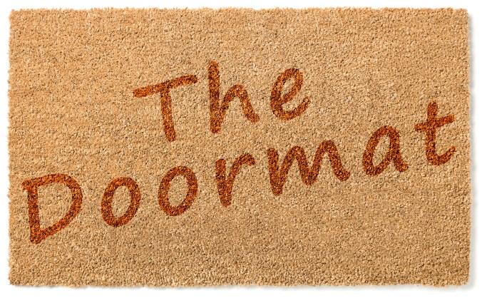 Doormat picture with words The Doormat on it to represent the passive doormat