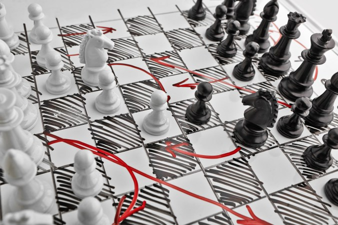 Chess. White board with chess figures on it. Plan of battle. Strategy.