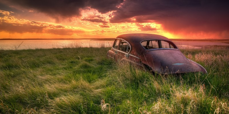 Old car in field