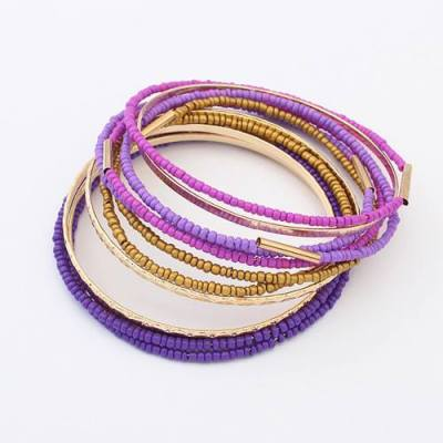 Purple and gold bangles