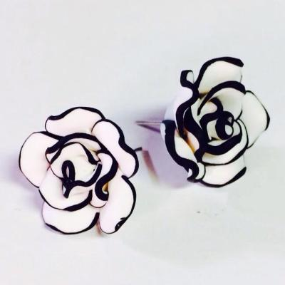 Black and white rose studs