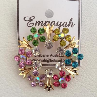 Fine halo style gold and mulitcoloured rhinestone brooch