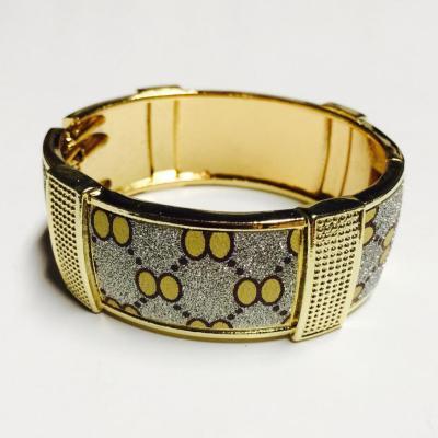 Gold patterned sparkly bangle
