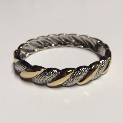 Silver and gold intertwined bangle