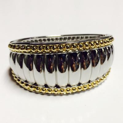 Silver and gold varigated sized bangle