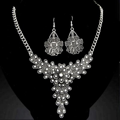 Feathered metal and rhinestone necklace and earrings in silver