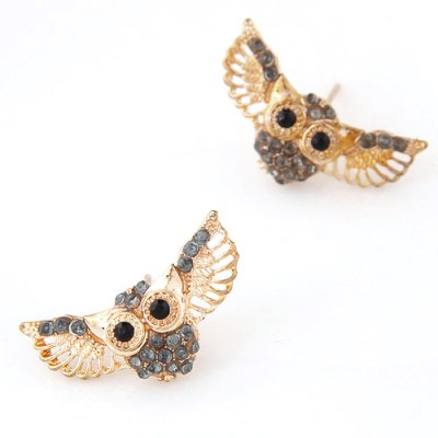 Rhinestone encrusted owl stud earrings in gold