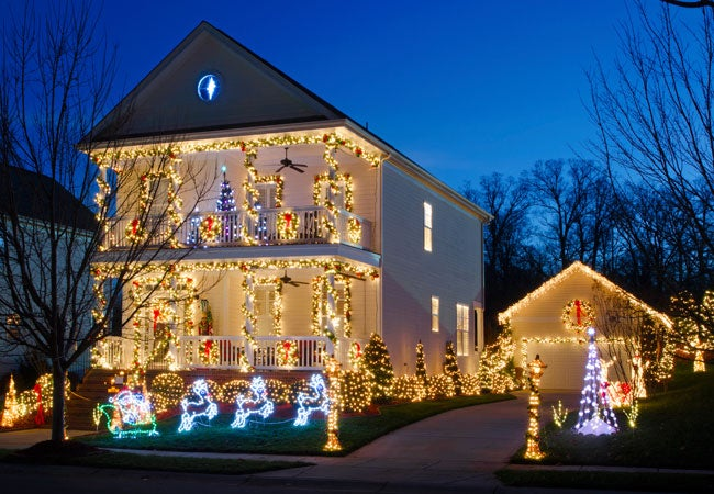 how to hang christmas lights outside on the roof porch and trees bob vila