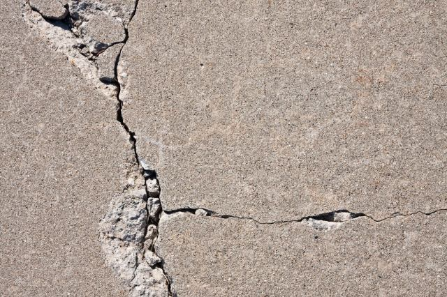 Solved! What to Do About Cracks in a Concrete Driveway - Bob Vila