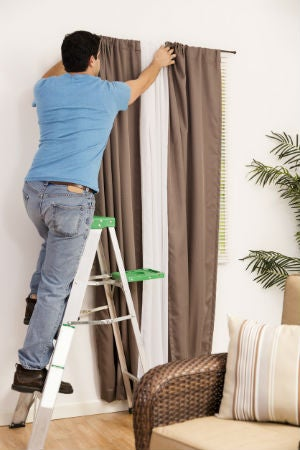 how high to hang curtains above windows