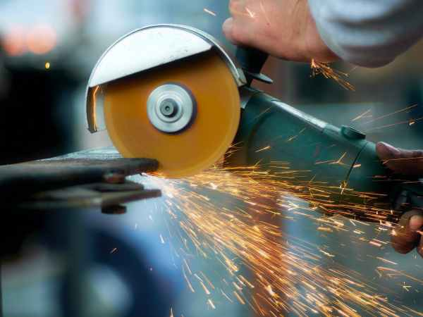 crop blacksmith cutting metal with grinder