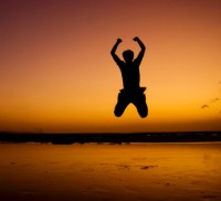 man jumping with exhilaration