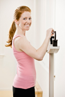 Young woman on scales after exercising.