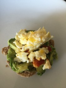 Half whole wheat English Muffin with half of an avocado and one egg