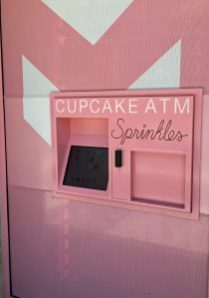 "Sprinkles Cupcake ATM: A pink bundle of joy putting smiles on people's faces  2 So there I was, standing in front of a pink ATM tucked in the side of a building. OK in all honesty, I did not have a craving. I was walking by on the street and saw the cupcake ATM sign and said, ""whaaat?? This is crazy! So crazy I have to try it!"" More honesty, it was not 2 a.m. but a sensible 3 in the afternoon so I could have a pre-snack before dinner. Everyone knows - life is short, have dessert first."