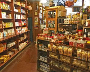 antique wood grocery store shelves filled with unusual food items