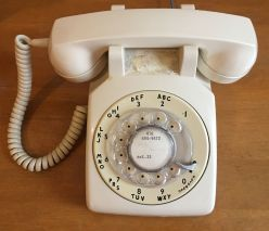 an ivory colored rotary phone