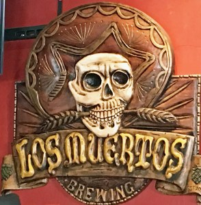 a picture of Los Muertos sign, Puerto Vallarta's first microbrewery