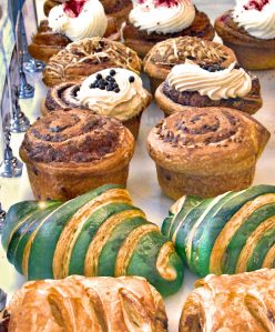 freshly baked muffins, croissants, and pastries