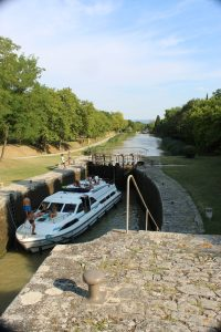 Canal du Midi Guide: A Must Read For Cruising 3 Trebes is a charming town with several quaint restaurants located directly on the canal for waterfront dining. Trebes is an ideal spot for fresh Mediterranean seafood. A must do activity in Trebes for food lovers is to take a cooking class at Cooking by the Canal du Midi. The classes, taught in English, show how to recreate the diverse and flavorful dishes of France easily.