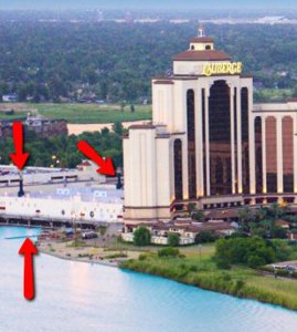 The arrows point to the casino section of the resort located over water and the smoke stack from the barge. Photo credit: Lake Charles Southwest Louisiana CVB