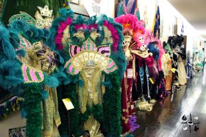 one of the hallways of the Mardi Gras Museum lined with costumes