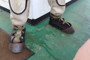 lead toed boots of the sea sponge diver