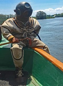 sea sponge diver sitting on the edge of a boat