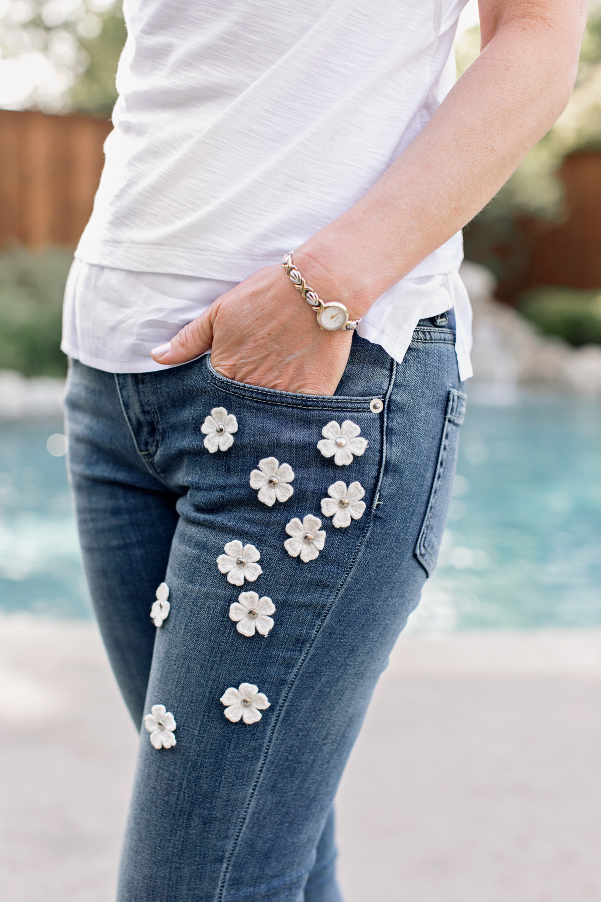 details, detaiing, embellishments, cece floral embellished jeans, jeans with white flowers, vince camuto ruffle sleeve tee, estella Bartlett embossed pouch, cece classic lace hem skinny white jeans, scallop hem white jeans, white skinny jeans with embroidered hem, embroidered hem, white embellished jeans, ted baker floral applique sleeve tee, floral applique tee, ted baker tee, ruffle sleeve tee, white leather pouch, silver monogram necklace, bauble bar earrings, bauble bar earrings with jeans, bauble bar earrings good with jeans, cece tie neck denim dress, tie neck denim dress, denim dress with tie at neck, denim dress bow neck, bow neck denim dress, cece tie-neck denim dress, denim dress, denim dress with bow, empty nest, empty nester, empty nesters, empty nest syndrome, empty nest help, fashion over 50, empty nest blog