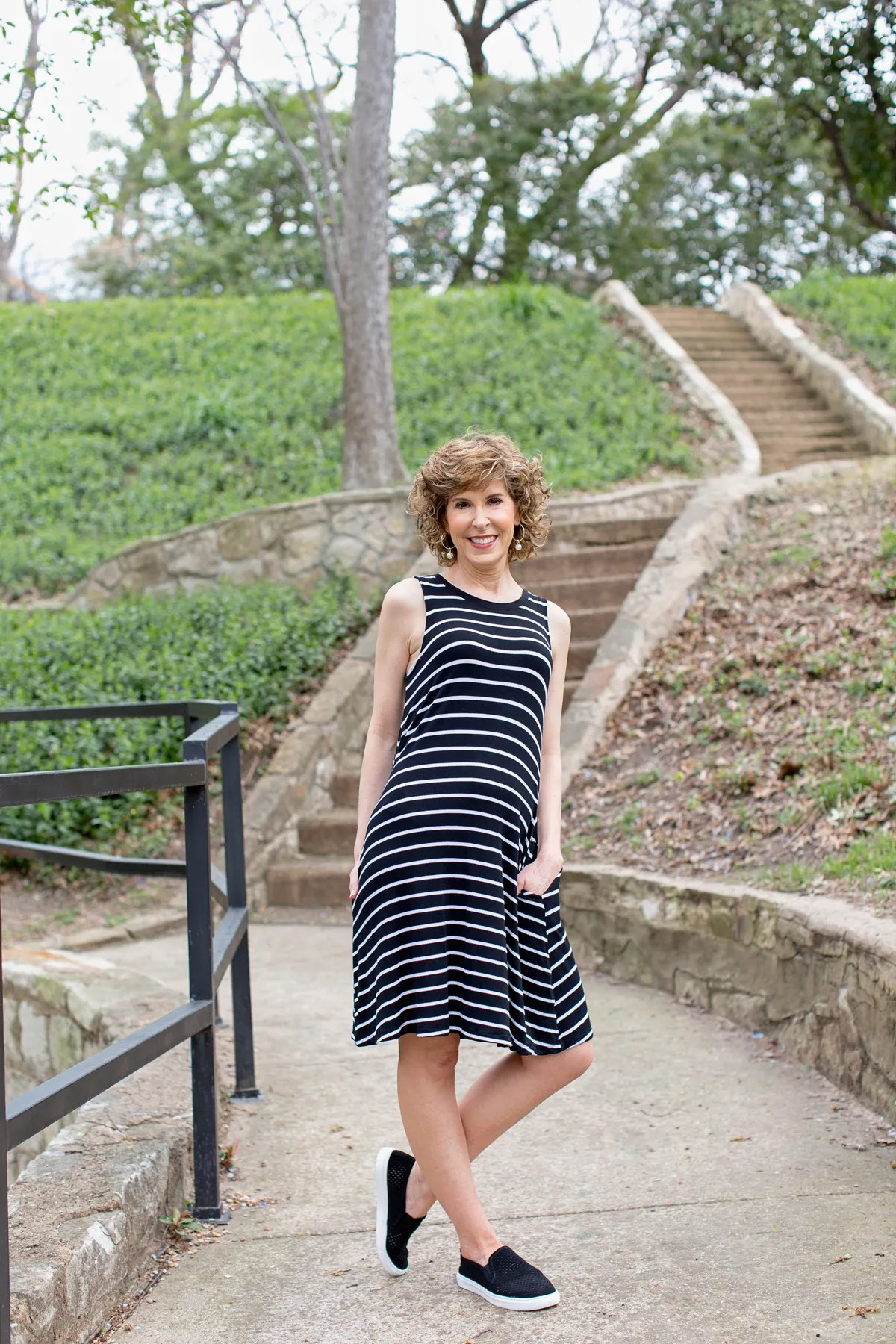 woman in black and white striped dress in park