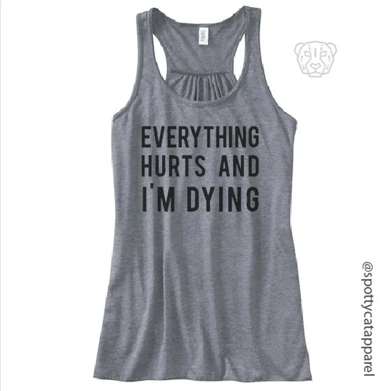 gray workout top with black writing everything hurts and i'm dying