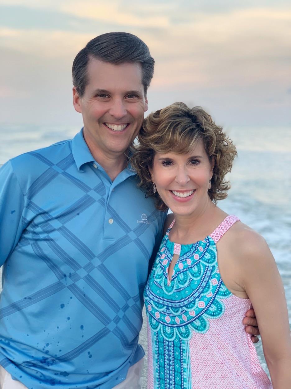 couple on the beach at sunset on sanibel island