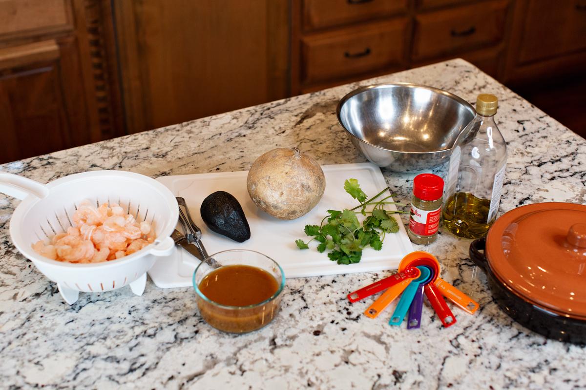 woman making southwestern shrimp recipe in kitchen