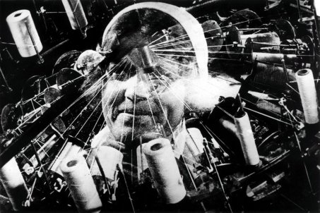 man-with-a-movie-camera-1929-003-head-superimposed-on-sewing-machine.jpg
