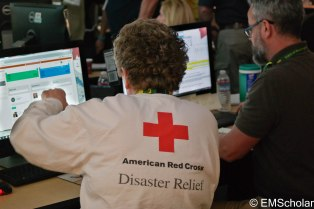 The Red Cross personnel help operations staff set up mass care shelters.