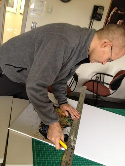 Yago prepares his paintings